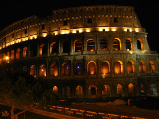 A picture taken at night of the Colosseum